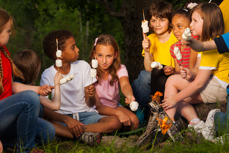 Group of children with smores near bonfire