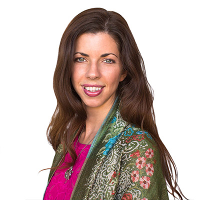 Amanda Couture wearing a multicolored shawl with a magenta blouse.
