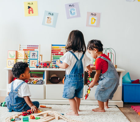 Young kids playing in playroom
